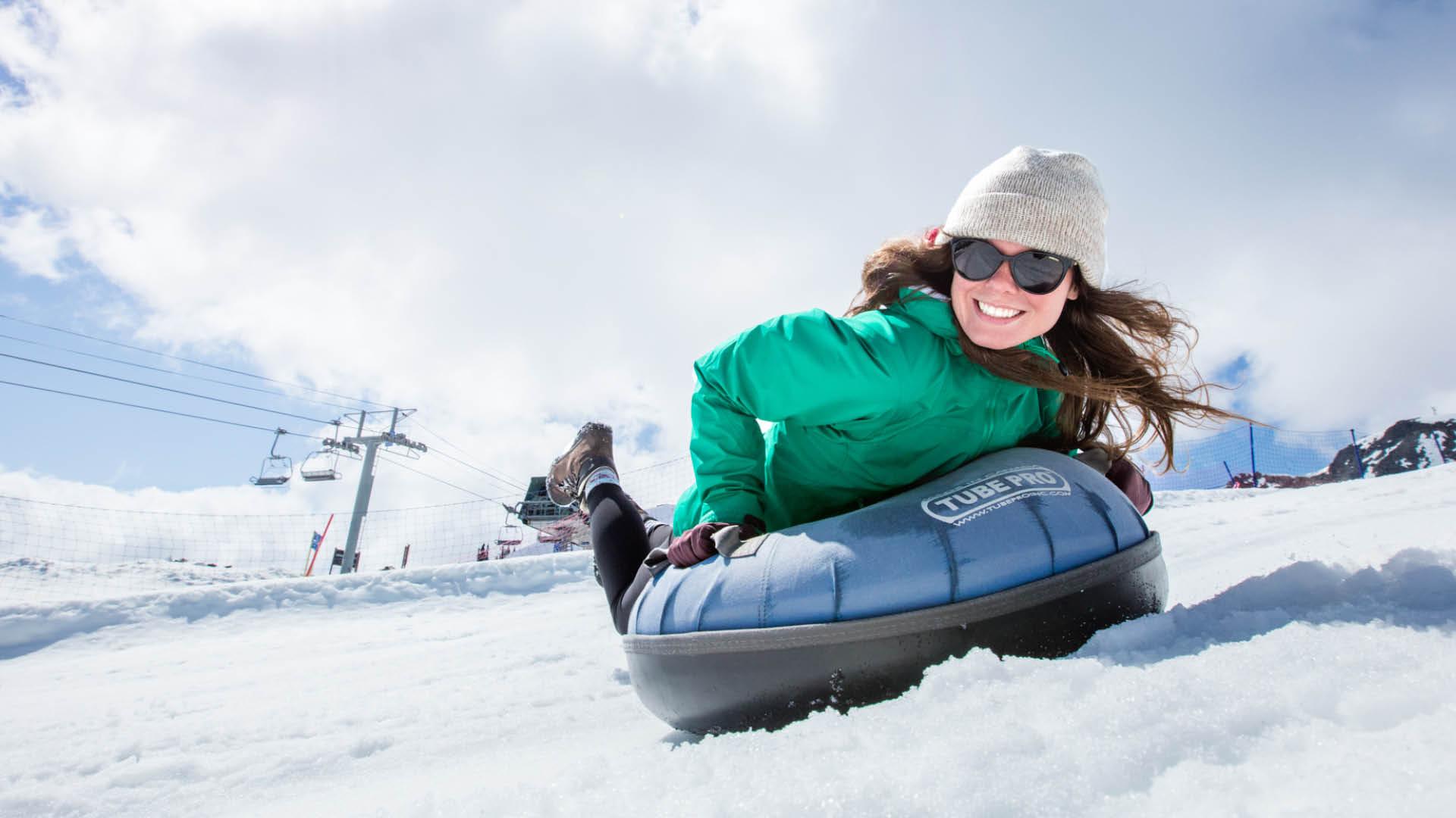woman sliding on a tube