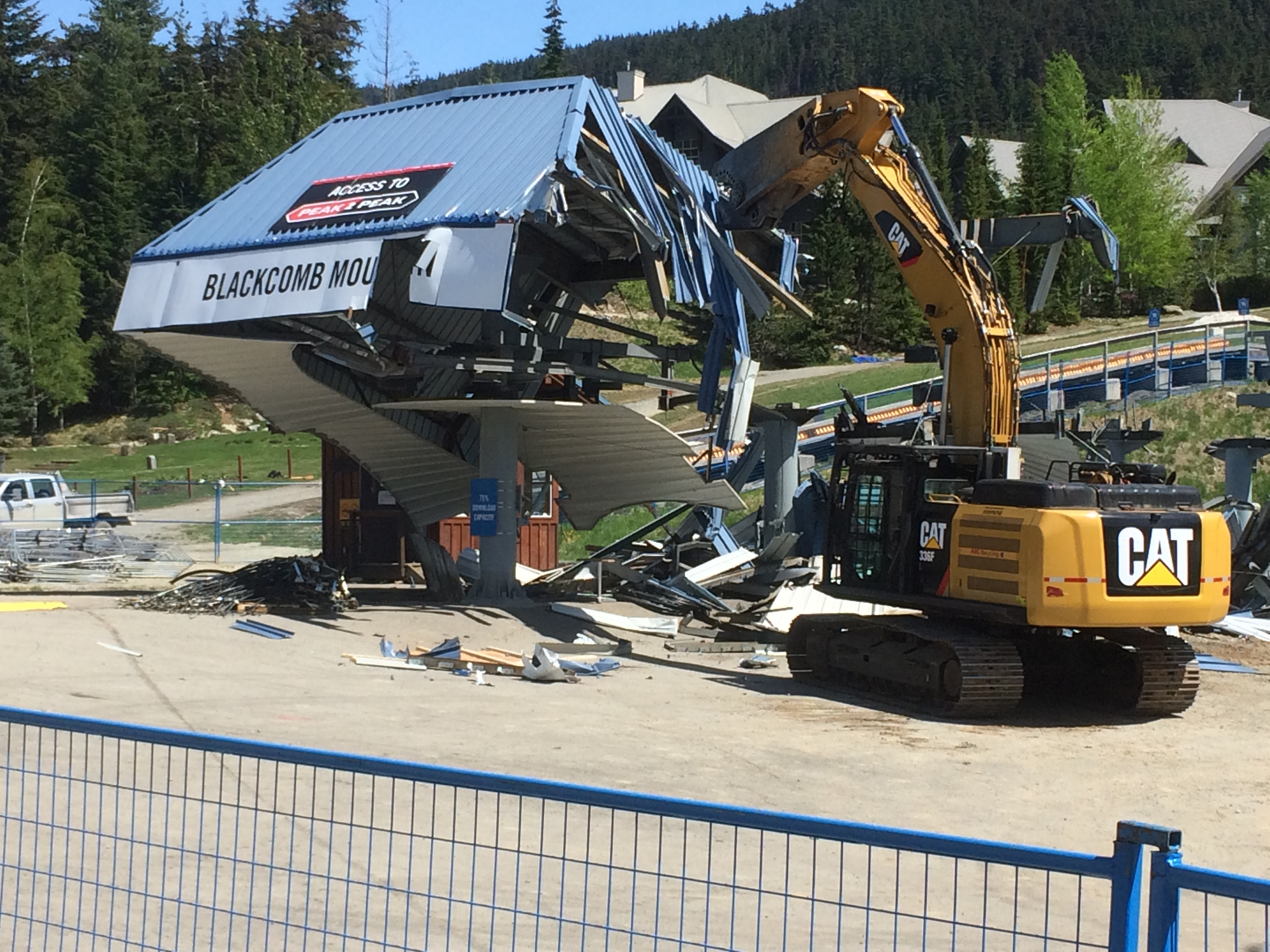 Chairlift being demolished with machinery