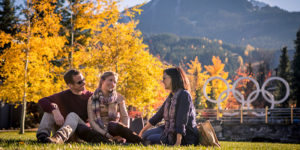 People enjoying Whistler village on sunny fall day.